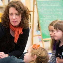 Children hearing book being read