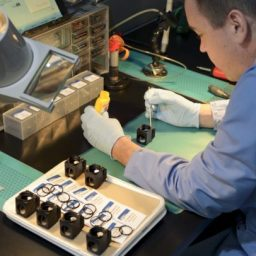 Derek Trudelle assembles filter sets into microscope filter cubes at Chroma in Bellows Falls, a manufacturer of optical filters. Photo courtesy Chroma